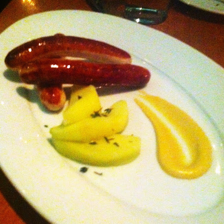 Rabbit boudin blanc with sautéed granny smith apples and dijon mustard