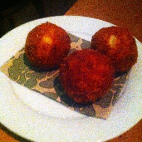 Polenta croquettes stuffed with raclette cheese