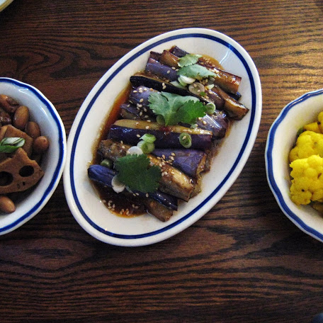 Trio of pickles: ginger lime cauliflower, sichuan eggplant, and Charlie's peanuts