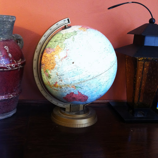 Globe and other pieces along the counter at Eva's Cafe