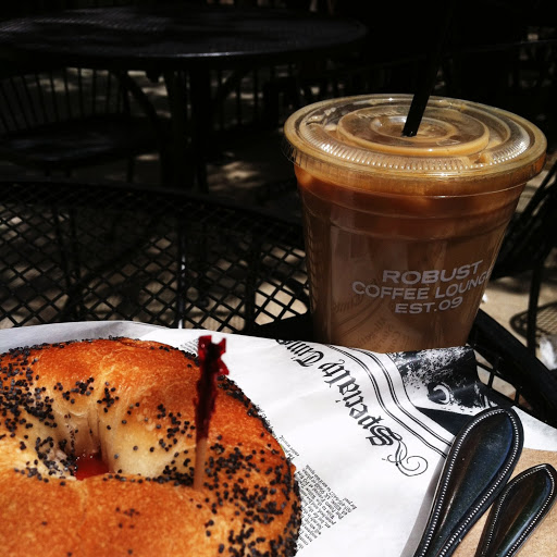 Iced latte and bagel sandwich on the patio at Robust Coffee Lounge