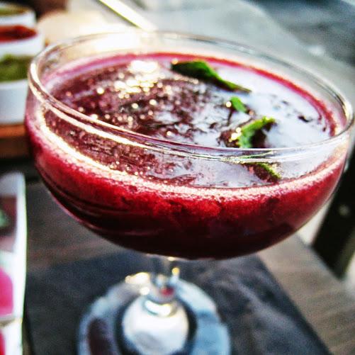 ¿Por qué No? cocktail with lemon, blueberry, peach, and Sombra Mezcal