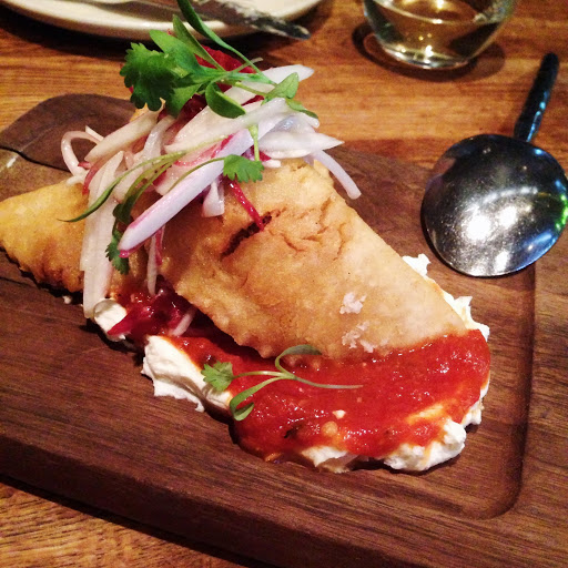 Goat empanadas with romesco and radish-endive slaw