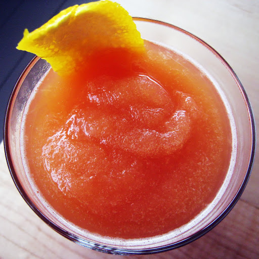 Negroni slushy with letherbee gin, luxando bitter, sweet vermouth, and citron