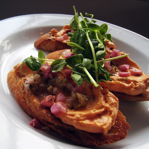 Toast with pimento cheese, charred radishes, and pea shoots
