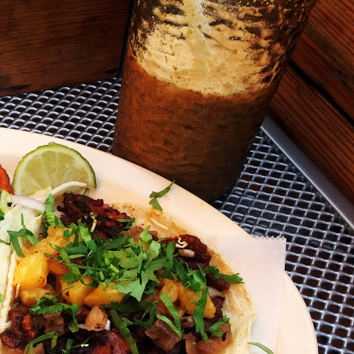 Dulce de leche licuado (milkshake) and taco al pastor, with marinated, spit-roasted pork shoulder, grilled pineapple, grilled onion, and cilantro