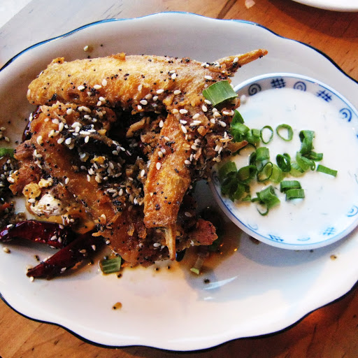 Everything wings glazed with soy, jaggery and dried chilis, tossed with sesame, poppy seed, fried shallots, and served with tzatziki