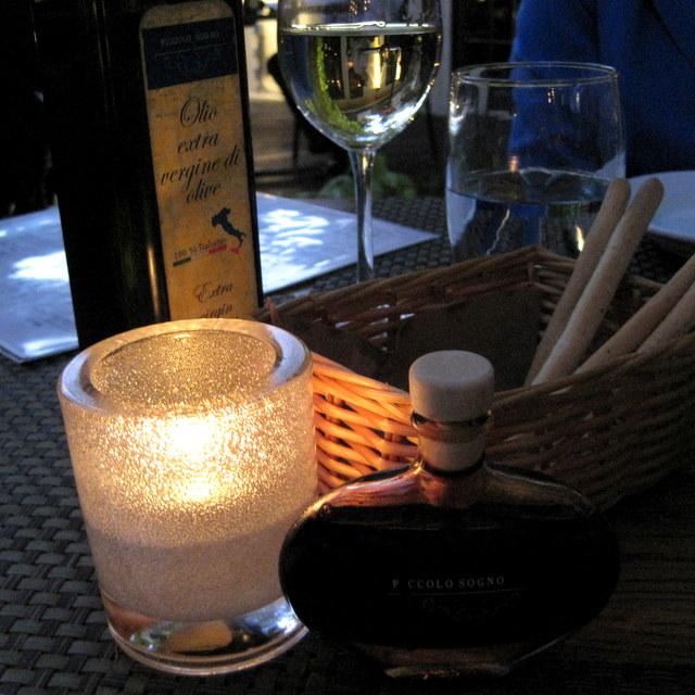Bread basket with house-bottled olive oil and aged balsamic vinegar