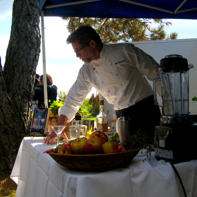 Chef Rick Bayless preparing guacamole and margaritas in his cooking demo before the meal