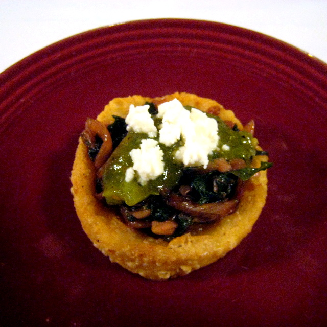 Masa boat with braised chard, caramelized onions, Prairie Fruits Farm feta, and salsa verde