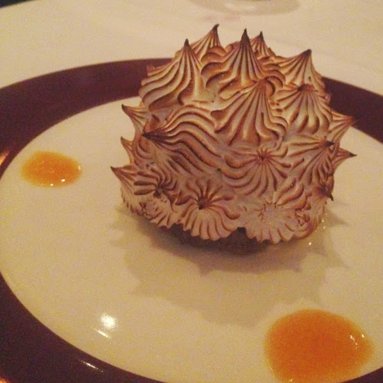 Classic baked Alaska with walnut cake, apricot jam, banana gelato, meringue, and crème anglaise